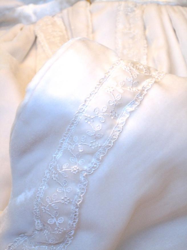closeup of velvet christening coat