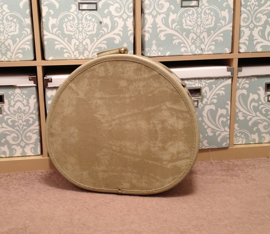 Original, ugly hatbox. Circa 1960s, nasty mottled beige vinyl, interior lined with unpleasant olive green polyester.