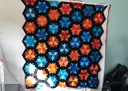 cyan and orange night sky quilt