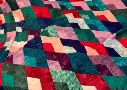 huge jewel tone boomerang quilt